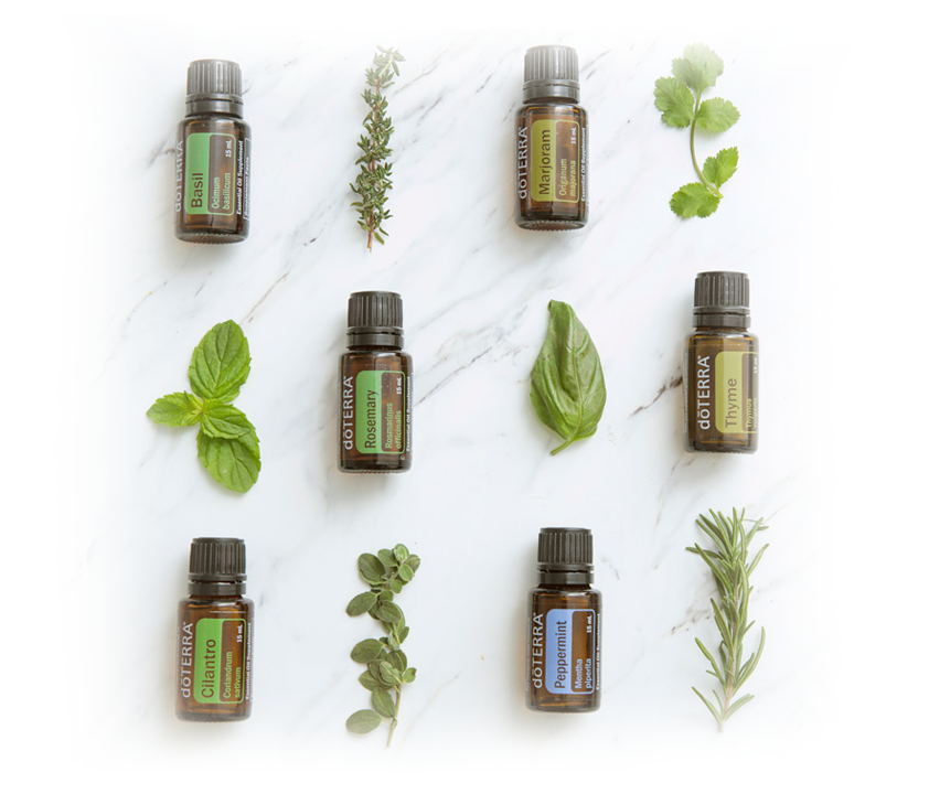 Doterra oil and herb displayed on marble